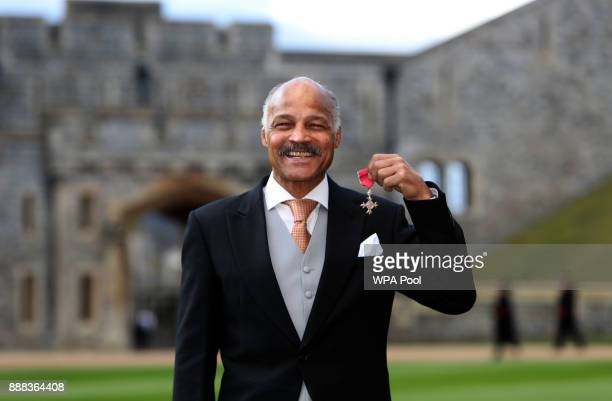 Former boxer John Conteh after being made an MBE by Queen Elizabeth II during an investiture ceremony at Windsor Castle on December 8 2017 in Windsor...