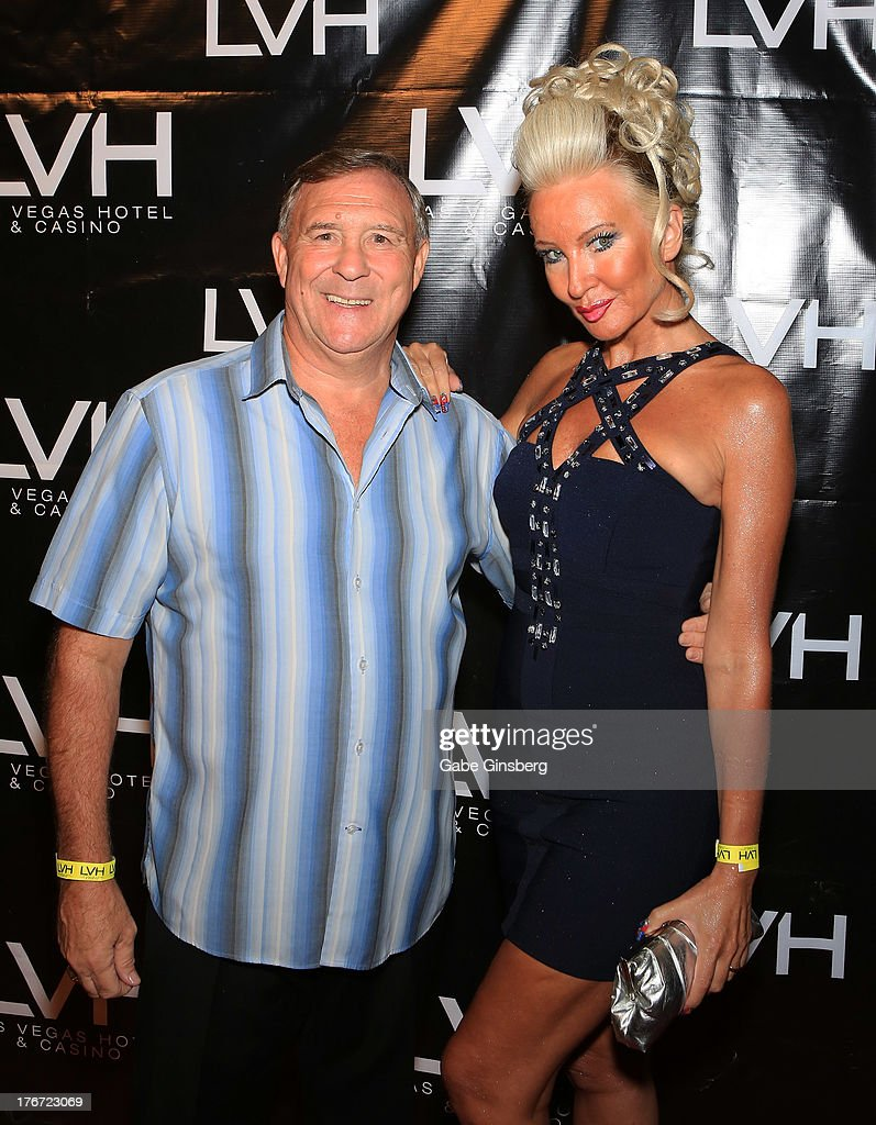 Former boxer John H. Stracey (L) and his wife Kathy Stracey arrive at the 'Night of the Champion' event to honor former boxer Leon Spinks hosted by the cast members of 'Raiding the Rock Vault' at The Las Vegas Hotel & Casino on August 17, 2013 in Las Vegas, Nevada.