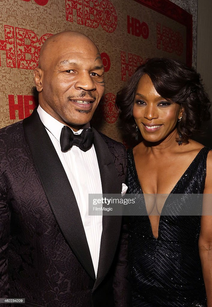 Former boxer Mike Tyson and actress Angela Bassett attend HBO's Official Golden Globe Awards After Party at The Beverly Hilton Hotel on January 12, 2014 in Beverly Hills, California.