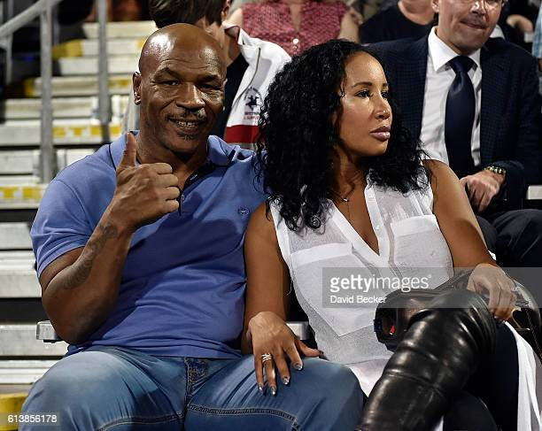 Former boxer Mike Tyson and his wife Lakiha Kiki Tyson attend the World TeamTennis Smash Hits charity tennis event benefiting the Elton John AIDS...
