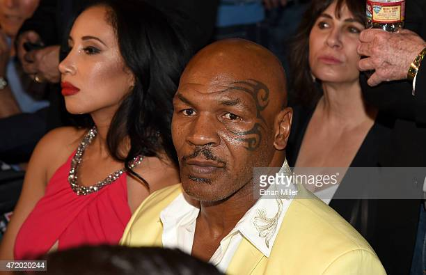 Former boxer Mike Tyson and his wife Lakiha Kiki Tyson sit ringside at Mayweather VS Pacquiao presented by SHOWTIME PPV And HBO PPV at MGM Grand...