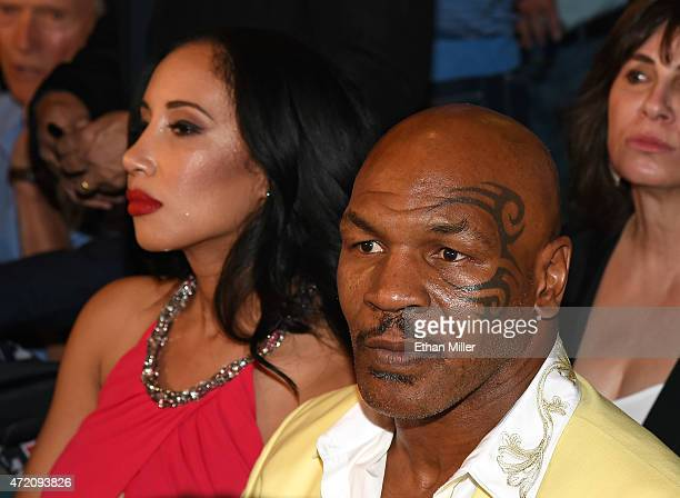 Former boxer Mike Tyson and his wife Lakiha 'Kiki' Tyson sit ringside at 'Mayweather VS Pacquiao' presented by SHOWTIME PPV And HBO PPV at MGM Grand...