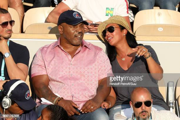 Former Boxer Mike Tyson and his wife Lakiha Spicer are seen supporting Serena Williams during the 2018 French Open Day Seven at Roland Garros on June...