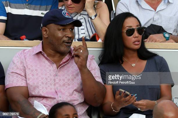 Former Boxer Mike Tyson and his wife Lakiha Spicer are seen supporting Serena Williams during the 2018 French Open - Day Seven at Roland Garros on...