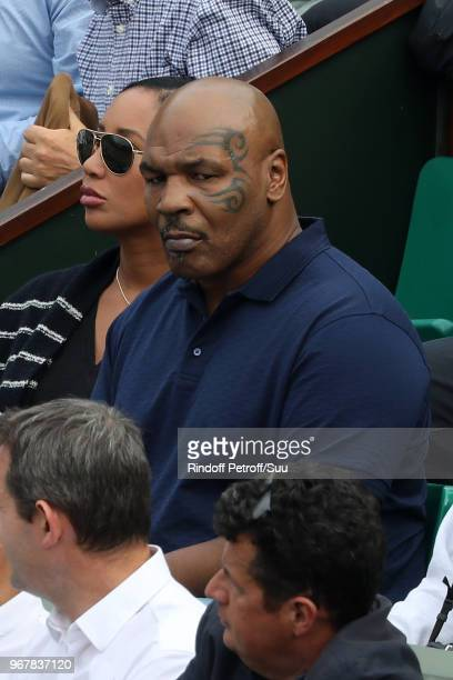 Former boxer Mike Tyson and his wife Lakiha Spicer attend the 2018 French Open Day Ten at Roland Garros on June 5 2018 in Paris France