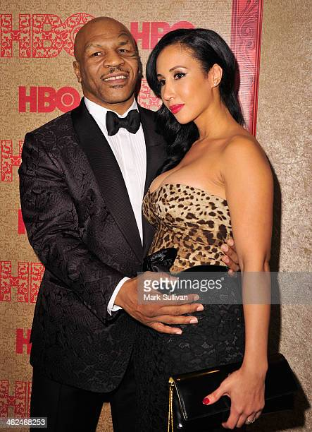 Former boxer Mike Tyson and Lakiha Kiki Spicer attend HBO's Post Golden Globe Party at Circa 55 Restaurant on January 12 2014 in Beverly Hills...