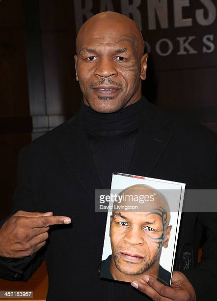 "Former boxer Mike Tyson attends a signing for his book ""Undisputed Truth"" at Barnes & Noble bookstore at The Grove on November 26, 2013 in Los..."