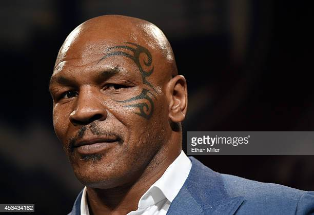 Former boxer Mike Tyson inducts Evander Holyfield into the Nevada Boxing Hall of Fame at the second annual induction gala at the New Tropicana Las...