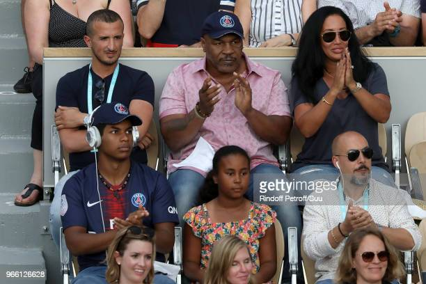 Former Boxer Mike Tysonhis wife Lakiha Spicer his daughter Milan and his son Morocco are seen supporting Serena Williams during the 2018 French Open...