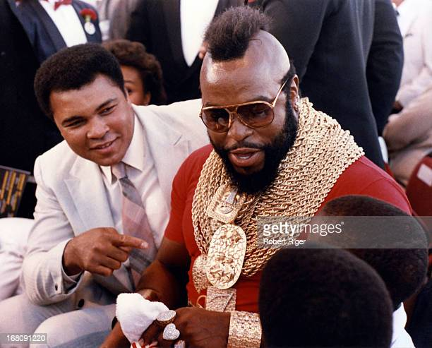 Former boxer Muhammad Ali and celebrity actor Mr T talk to fans before the IBF Heavyweight Title fight with Michael Spinks and Larry Holmes on...