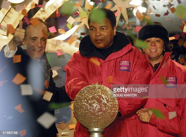 Former boxer Muhammad Ali is joined by his wife Lonnie and New York Mayor Rudy Giuliani in Times Square 31 December 2000 Ali pressed the button to...