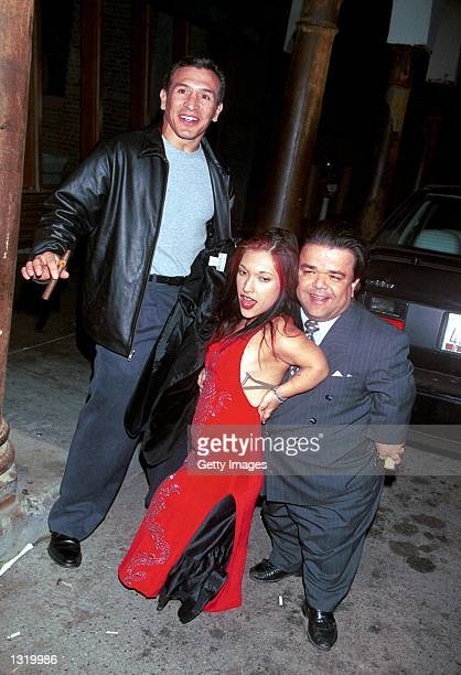 Former boxer Ray Boom Boom Mancini left poses with actors Bridgette Powers and Gary Friedkin during a party and final shoot for Joe Head Goes...