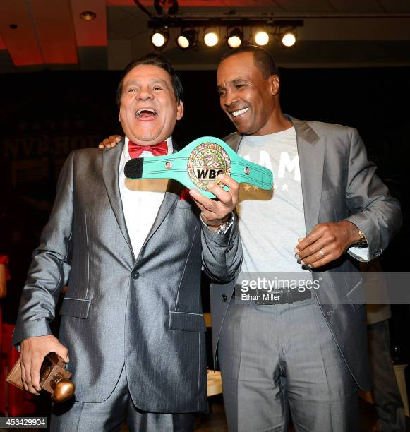 Former boxer Roberto Duran is inducted into the Nevada Boxing Hall of Fame by former boxer Sugar Ray Leonard at the second annual induction gala at...