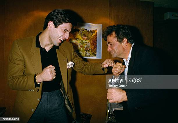 Former boxer Stephane Ferrara and American actor Peter Falk pretend to throw punches behind the scenes at ChampsElysees TV Show presented by Michel...