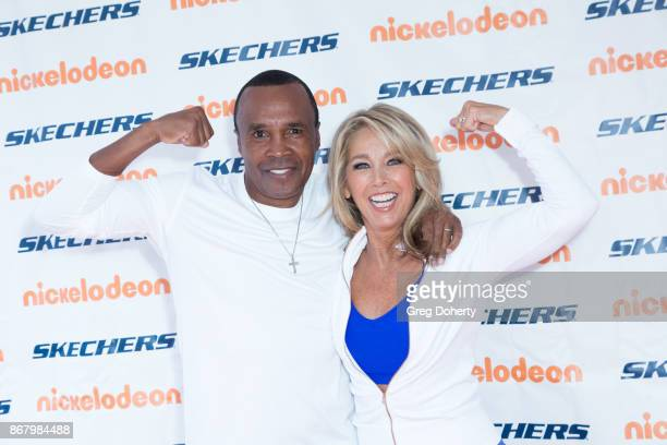 Former Boxer Sugar Ray Leonard and Fitness Enthusiast Denise Austin attend the Skechers' 9th Annual Pier To Pier Friendship Walk at Manhattan Beach...