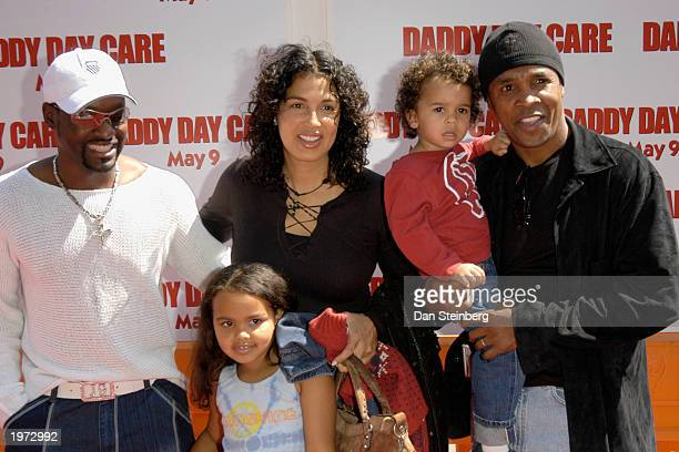 Former Boxer Sugar Ray Leonard with wife Bernadette children Camille and Daniel and Singer Johhny Gill arrive at the premiere of the feature film...