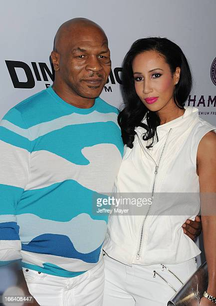Former boxer/actor Mike Tyson and Lakiha Spicer arrive at the 'Scary Movie V' Los Angeles Premiere at ArcLight Cinemas Cinerama Dome on April 11 2013...