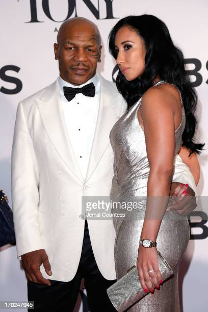 Former boxer/actor Mike Tyson and Lakiha Spicer attend The 67th Annual Tony Awards at Radio City Music Hall on June 9, 2013 in New York City.