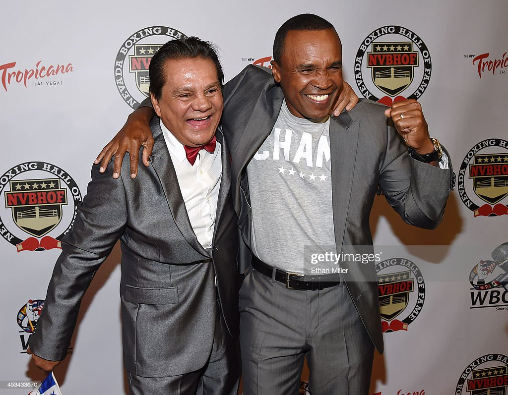 Former boxers Roberto Duran (L) and Sugar Ray Leonard arrive at the second annual Nevada Boxing Hall of Fame induction gala at the New Tropicana Las Vegas on August 9, 2014 in Las Vegas, Nevada. Leonard inducted Duran at the ceremony.