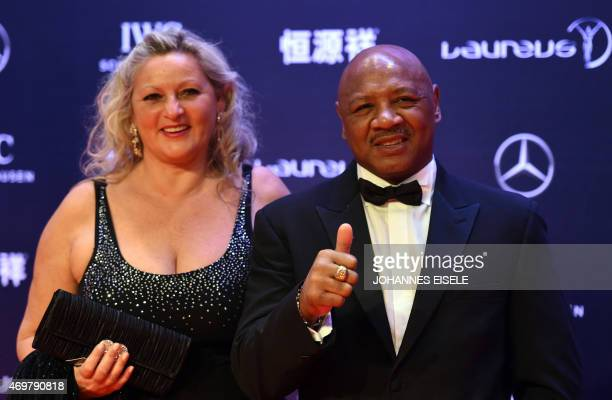 US former boxing champion Marvin Hagler and his wife Kay Guarrera pose on the red carpet ahead of the Laureus World Sports Award ceremony at the...