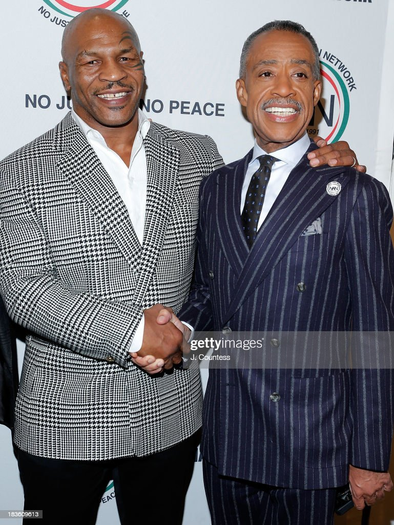 Former Boxing champion Mike Tyson and the President and founder of the National Action Network Reverend Al Sharpton attend The 4th Annual Triumph Awards at Rose Theater, Jazz at Lincoln Center on October 7, 2013 in New York City.