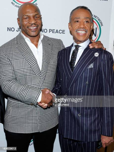 Former Boxing champion Mike Tyson and the President and founder of the National Action Network Reverend Al Sharpton attend The 4th Annual Triumph...