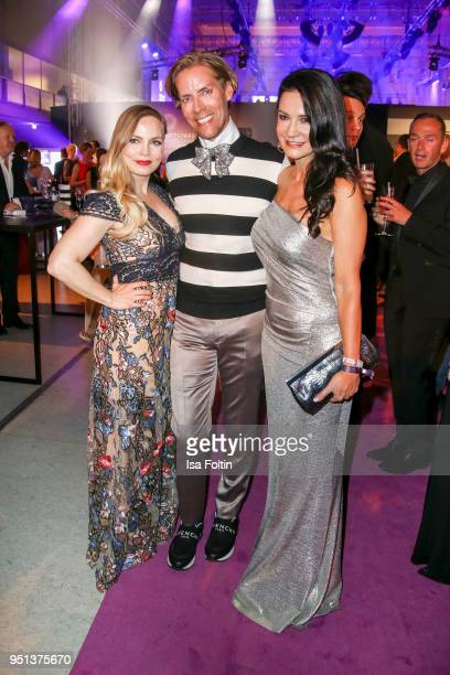 Former boxing champion Regina Halmich business man Jens Hilbert and German actress Mariella Ahrens during the after show party of Duftstars at...