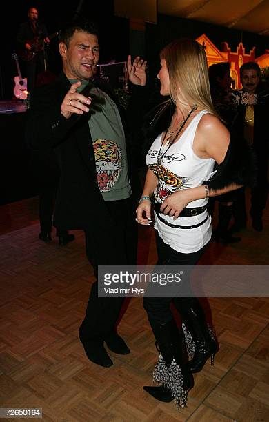 Former boxing star Dariusz Michalczewski dances with his partner Patricia Ossowska at the aftershow party of the Heavyweight boxing match between...