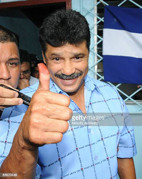 Former boxing world champion Alexis Arguello Managua's mayoral candidate for the Sandinista National Liberal Front gives his thumb up after casting...