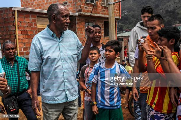 Former Boxing World Champion Antonio Cervantes 'Kid Pambele' greets locals during a charity visit to La Honda neighbourhood in Medellin Colombia on...