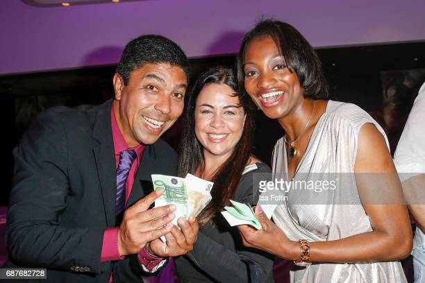 Former brasilian soccer player Giovane Elber with his wife Cintia Elber and Fashion Designer Hosana Charmite during the Kempinski Fashion Dinner on...