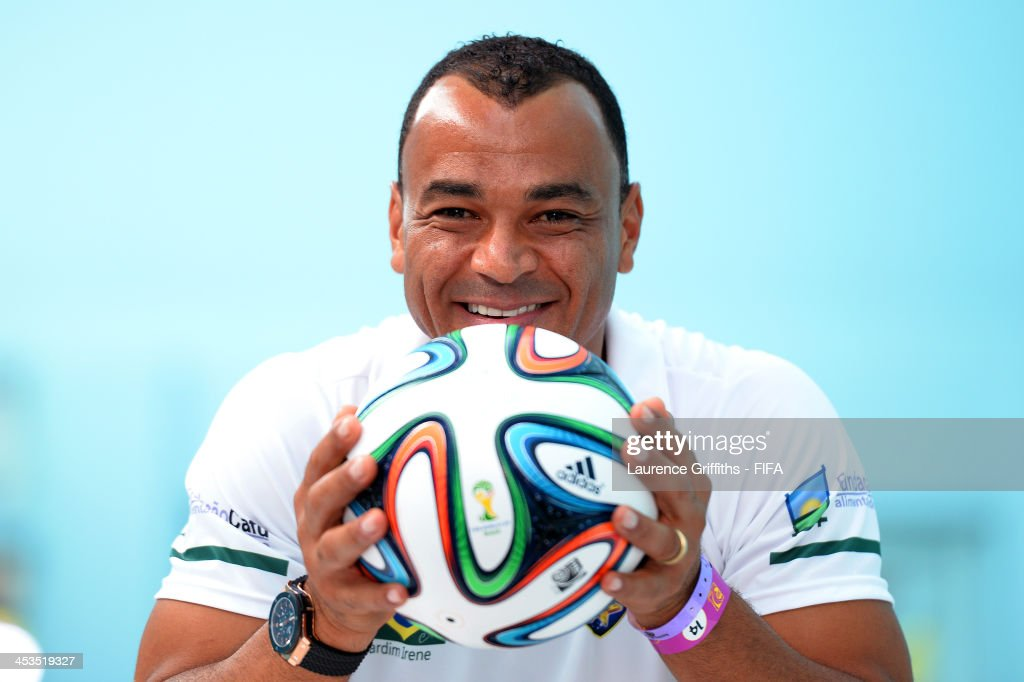 Former Brazil footballer Cafu poses with the adidas Brazuca, official match ball for the 2014 FIFA World Cup Brazil during previews ahead of the Final Draw for the 2014 FIFA World Cup at Costa do Sauipe Resort on December 4, 2013 in Costa do Sauipe, Brazil.