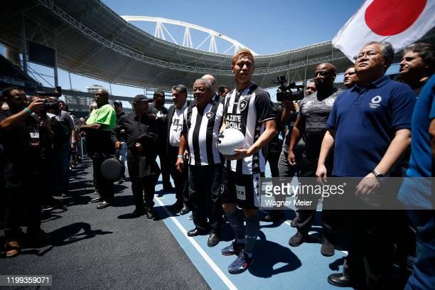 Former Brazil National team Jairzinho and Keisuke Honda. Brazilian team Botafogo presents Japanse player Keisuke Honda to the fans at Engenhao...