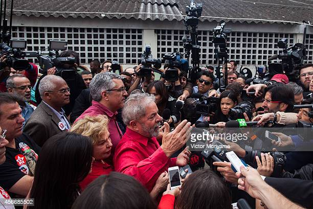 Former Brazil President Luiz Inacio Lula da Silva gives a statement after voting during the first round of presidential elections on October 5, 2014...