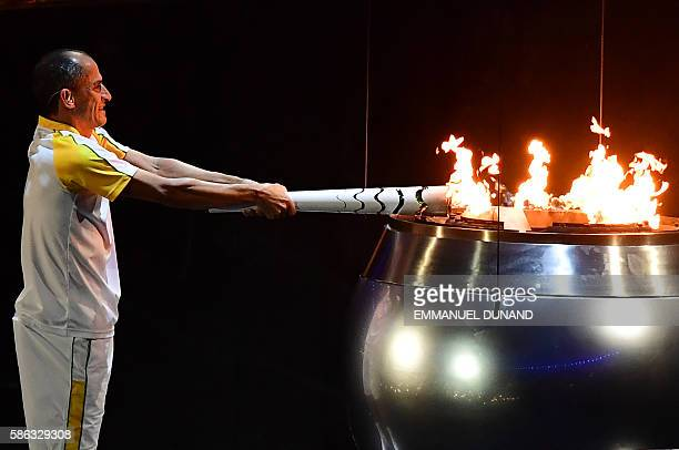 Former Brazilian athlete Vanderlei Cordeiro lights the Olympic cauldron with the Olympic torch during the opening ceremony of the Rio 2016 Olympic...