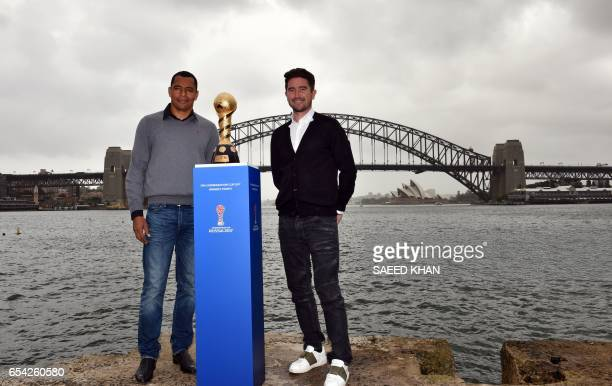 Former Brazilian football player Gilberto Silva and former Australian football player Harry Kewell pose for photos with the 2017 FIFA Confederations...