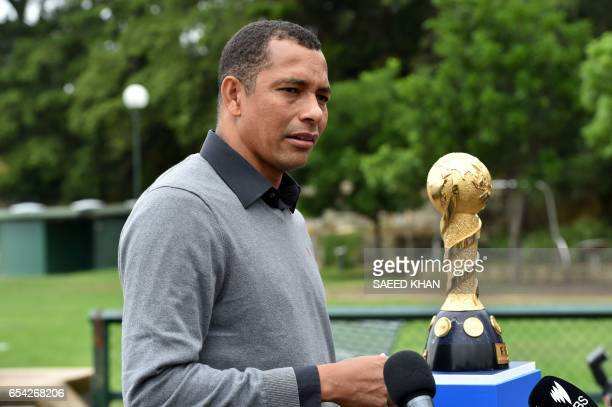 Former Brazilian football player Gilberto Silva talks to the media after posing for photos with the 2017 FIFA Confederations Cup at Blues Point...
