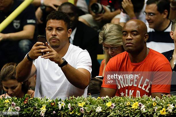 Former Brazilian football player Ronaldo and Brazilian Mixed Martial Artist Anderson Silva attend the Brazil Open single final match between Spain's...