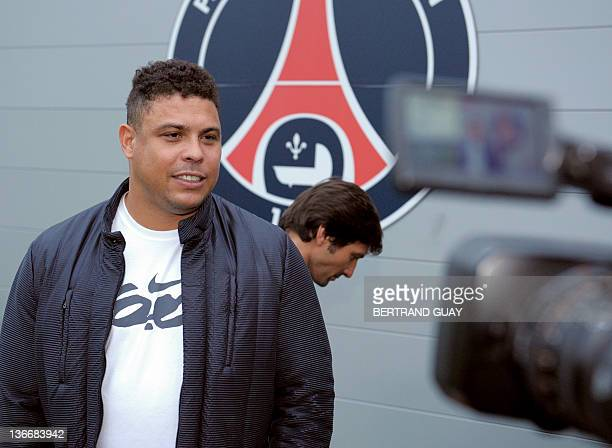 Former Brazilian football player Ronaldo poses next to Paris SaintGermain's sporting director Brazil's Leonardo on January 10 2012 in...