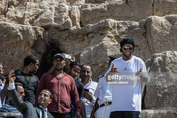 Former Brazilian football star Ronaldinho gestures during his tour of the Great Pyramids of Giza in Egypt on 05 July 2017.Ronaldinho arrived in Egypt...