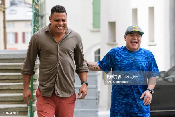 Former Brazilian football star Ronaldo and former Argentinian football star Diego Maradona arrive to take part in 'The Gianni's game the match of...