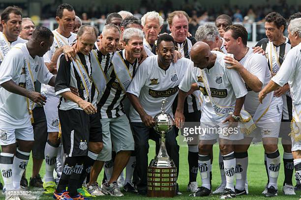 Former Brazilian footballer Edson Arantes do Nascimento aka 'Pele' ambassador of the 2014 World Cup celebrates with former teammates and the Copa...