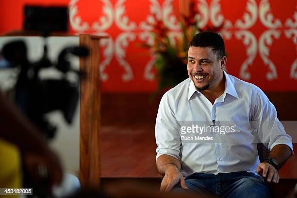 Former Brazilian footballer Ronaldo smiles during an interview ahead of the Final Draw for the 2014 FIFA World Cup at Costa do Sauipe Resort on...
