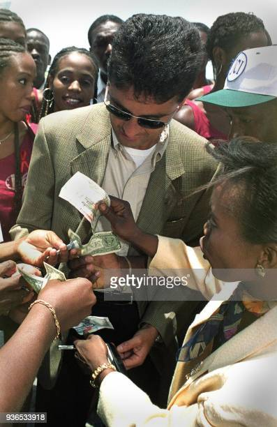 Former Brazilian International soccer star Bresil Bebeto signs autographs for fans 19 May 2002 in PortauPrince Haiti Bebeto announced at a press...
