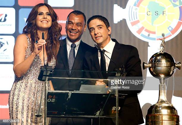Former Brazilian player Cafu presents Argentine singer Axel during the Official Draw of Bridgestone Libertadores Cup 2014 at CONMEBOL Building on...