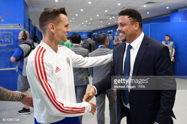 Former Brazilian player Ronaldo shakes hands with Denis Cheryshev of Russia prior to the 2018 FIFA World Cup Russia Group A match between Russia and...