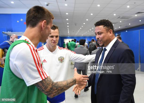 Former Brazilian player Ronaldo shakes hands with Fedor Smolov of Russia prior to the 2018 FIFA World Cup Russia Group A match between Russia and...