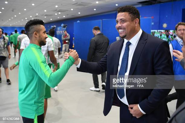 Former Brazilian player Ronaldo shakes hands with Hatan Bahbir of Saudi Arabia prior to the 2018 FIFA World Cup Russia Group A match between Russia...