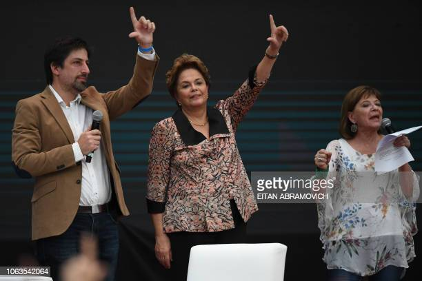 Former Brazilian president Dilma Rousseff flashes an Lsign referring to jailed former Brazilian president Luiz Inacio Lula da Silva during the First...