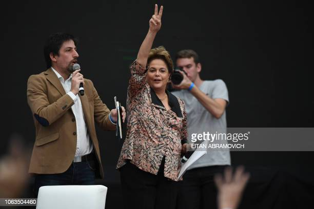 Former Brazilian president Dilma Rousseff flashes the vsign during the First World Critical Thinking Forum in Buenos Aires on November 19 2018 The...